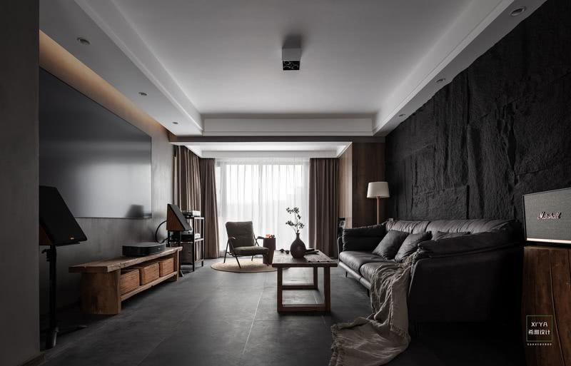 在大体块、立面以现代简约的线条、单色大体块为主基调,避免繁复及视觉疲劳。用黑、白、灰三个经典色比例的和谐分配,创造简约、统一的视觉;并且以水泥漆将客餐区做四面围合,让空间整体造型更加统一,视觉上也让人感到大气与神秘。
