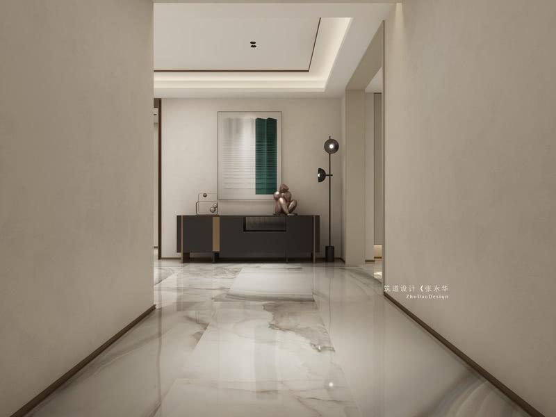 在进门处,设计师使用了大面积的米灰色艺术涂料,并且搭配白色的瓷砖,使得整个空间一下子明亮起来。