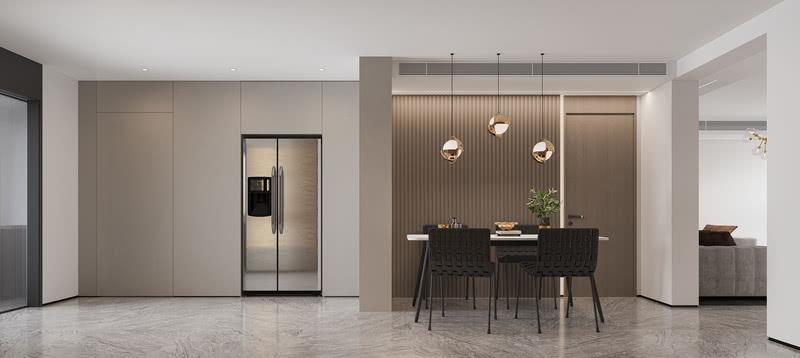 餐厅区域的墙面整体运用了护墙板造型,和旁边定制的到顶的木门相互搭配,视觉感官上尤为整体。